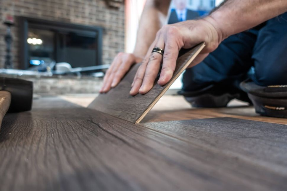 Man installing a laminated floor