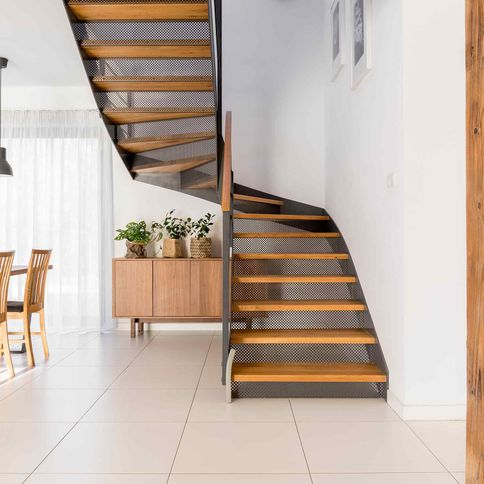 Tiled dining area with staircase