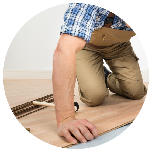 Man installing new hardwood floor
